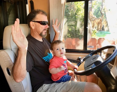 Casen driving rv with Poppa Tom