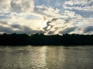 The stormy sunset on the river was beautiful.