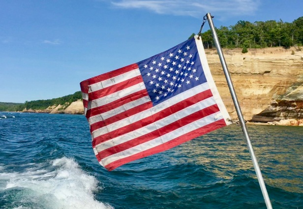 flag on boat at pictured rock